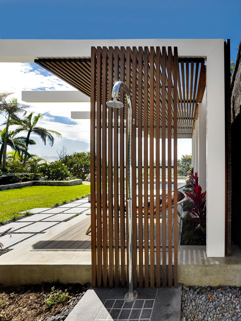 This wood and steel outdoor shower is ideal for rinsing off after a day at the beach.