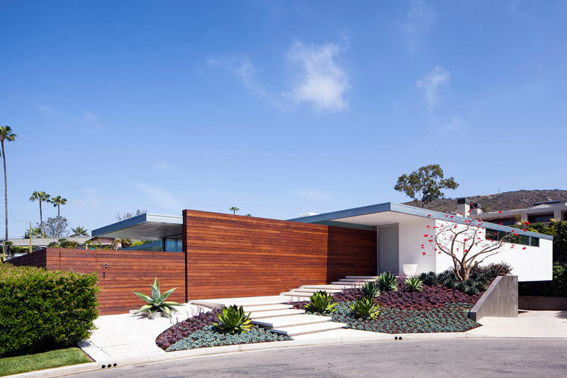 This Laguna Beach House has a landscaped front entrance, with great curb appeal and a path to guide you to the front door.