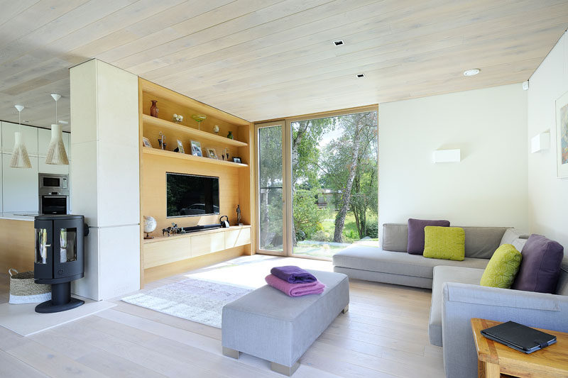 This space is filled with natural with oak, limestone and white paneled walls.