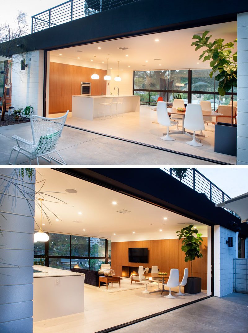The main floor of this home is open to the outdoor area to let the light to flood the space, and to create an indoor/outdoor living environment.