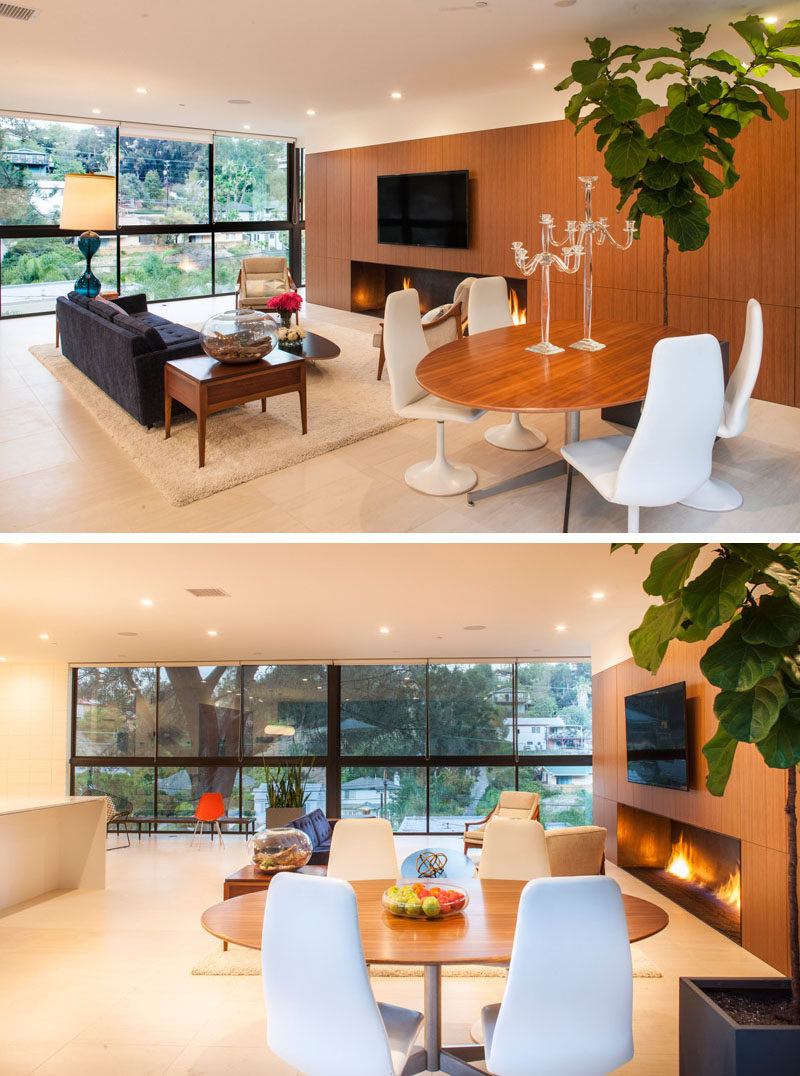 Next to the living area in this home is the dining area, with a circular dining table.