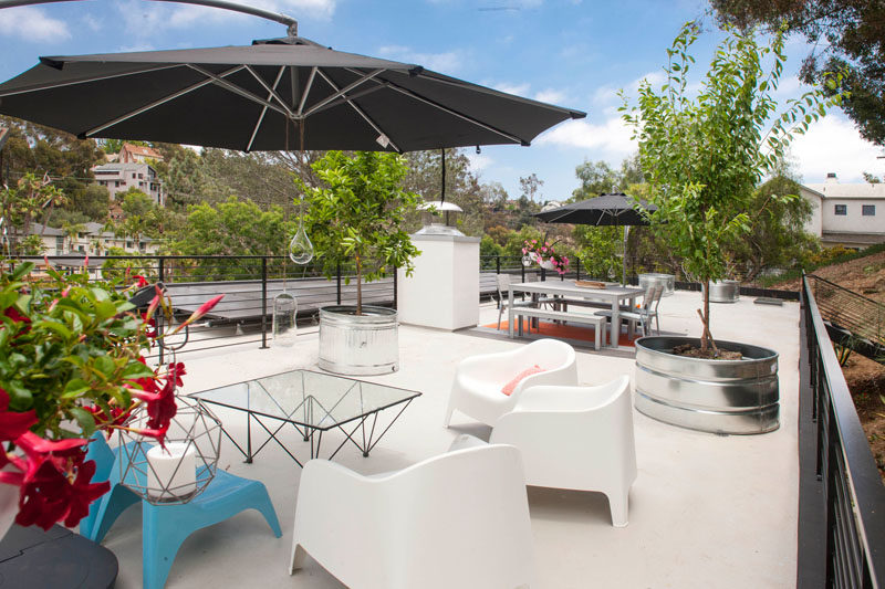 This home has a roof top deck with a lounge and dining area.