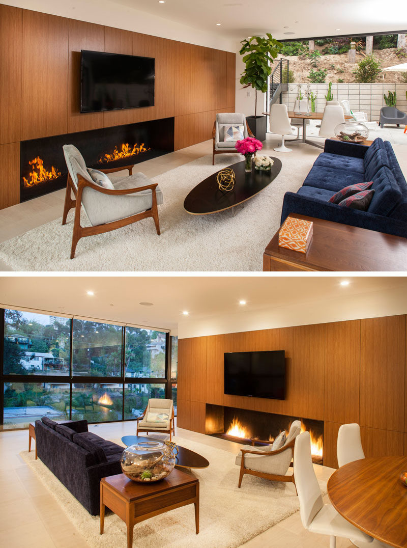 Inside this home there's an open floor plan, with the living room focused on the television and fireplace.