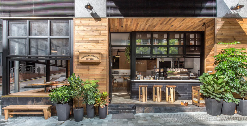 A brand new coffee shop has recently opened in Hong Kong, and they have dhas transformed this corner site and the character of the neighborhood by using warm materials and emphasizing indoor-outdoor engagement.