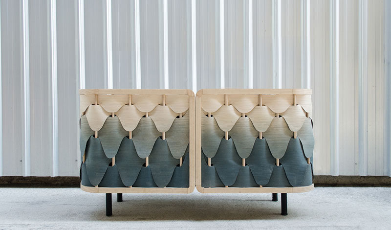 A Gradient Of Colorful Wood Veneers Cover This Cabinet