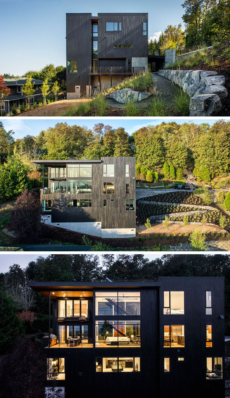 The home on a steep slope has a landscaped yard with a winding path leading to a small outdoor area.