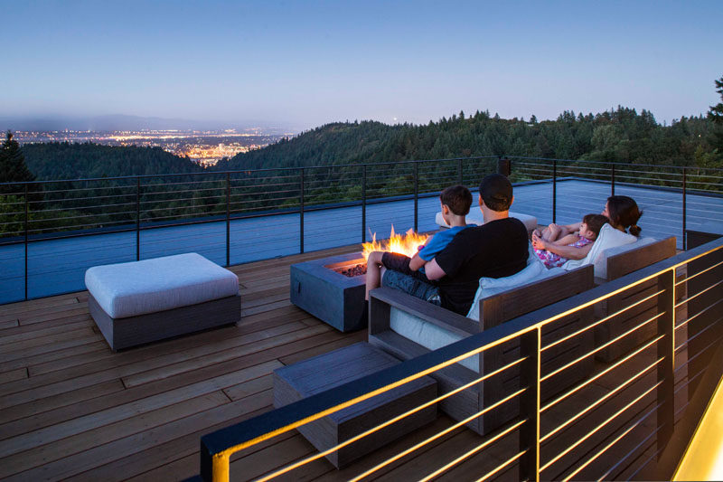 When this family wants some quiet time, they can retreat to the rooftop deck and sit by the outdoor fire.