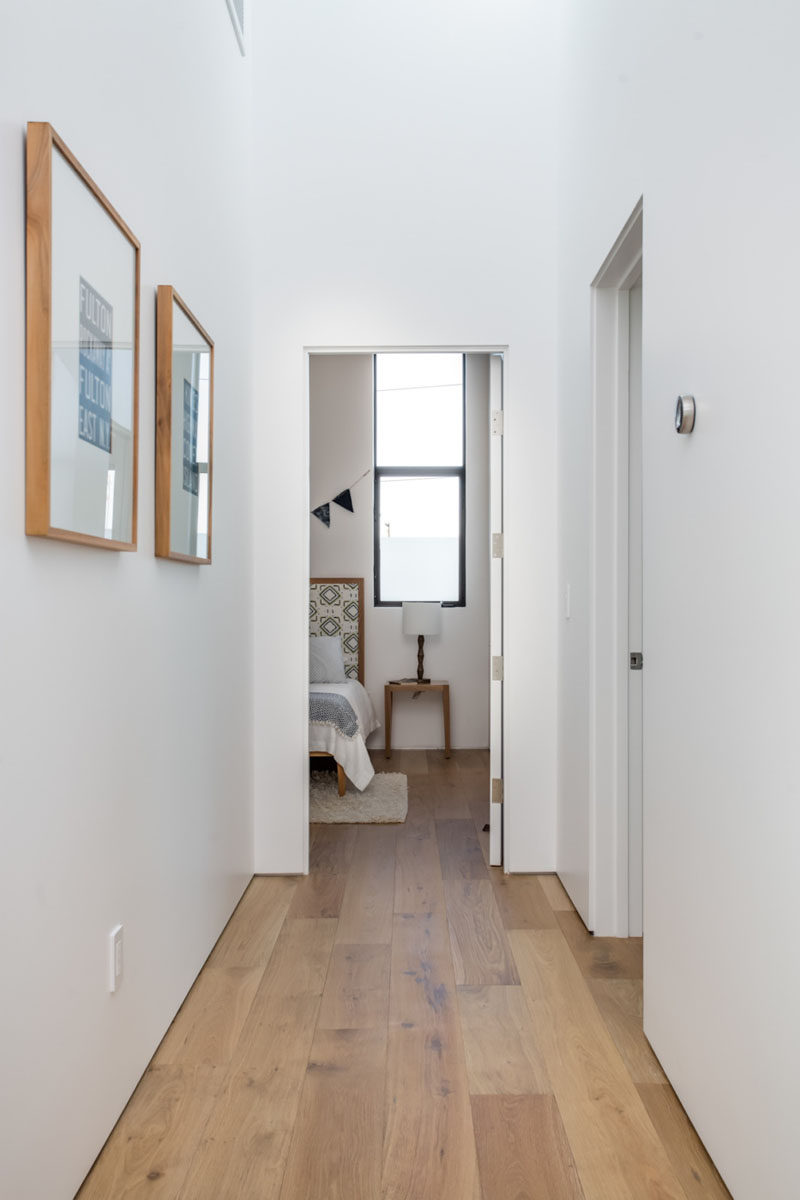 French oak flooring has been used in this hallway which also continues through to the bedrooms.