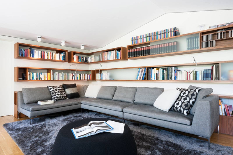 6 Design Ideas For Adding Corner Shelves To Your Home // Box Them In --- Two levels of wrap around, box-style shelving create an easily accessible home library.
