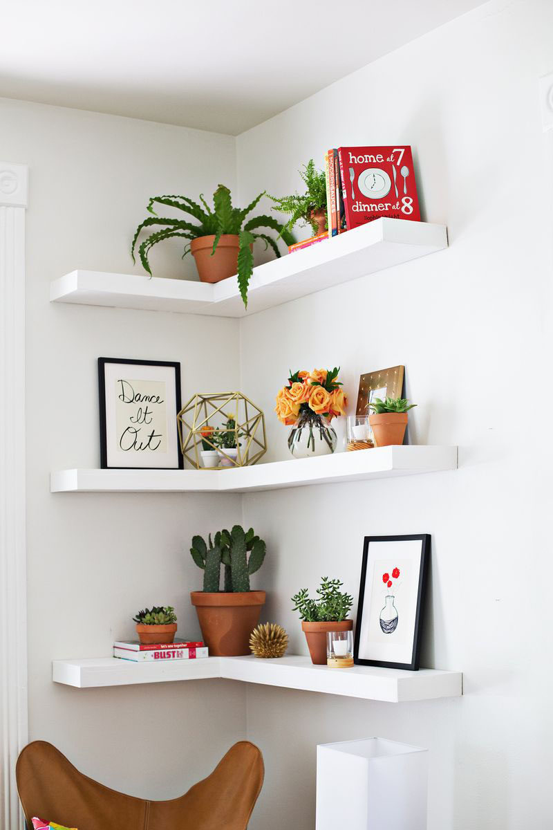 6 Design Ideas For Adding Corner Shelves To Your Home // Blend Them In --- These DIY white floating shelves against a white wall put less focus on the shelves and let the decor do the talking.