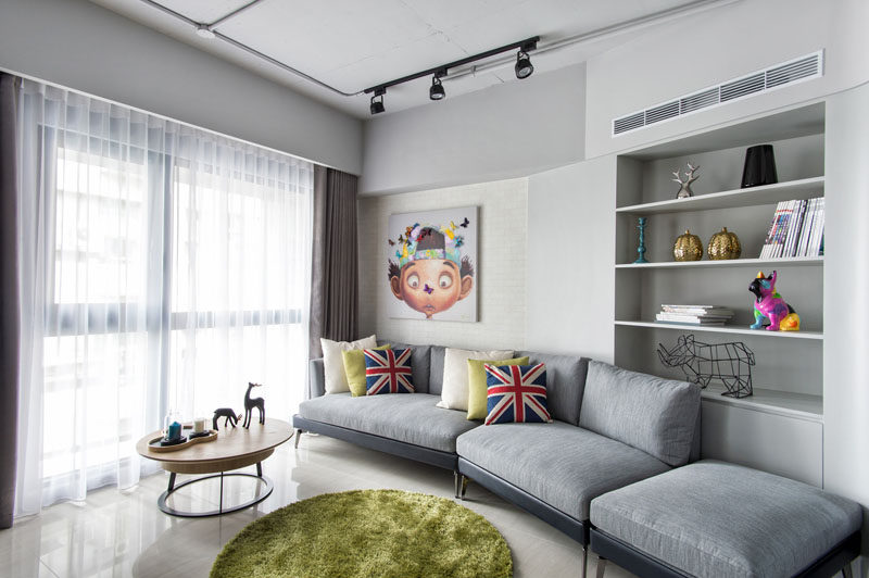 Apartment Design Idea - Divide Space By Slightly Elevating An Area. When interior design firm CHI-TORCH were designing this apartment in Taiwan, they decided to split the main living area into two distinct zones, a living room and an office.