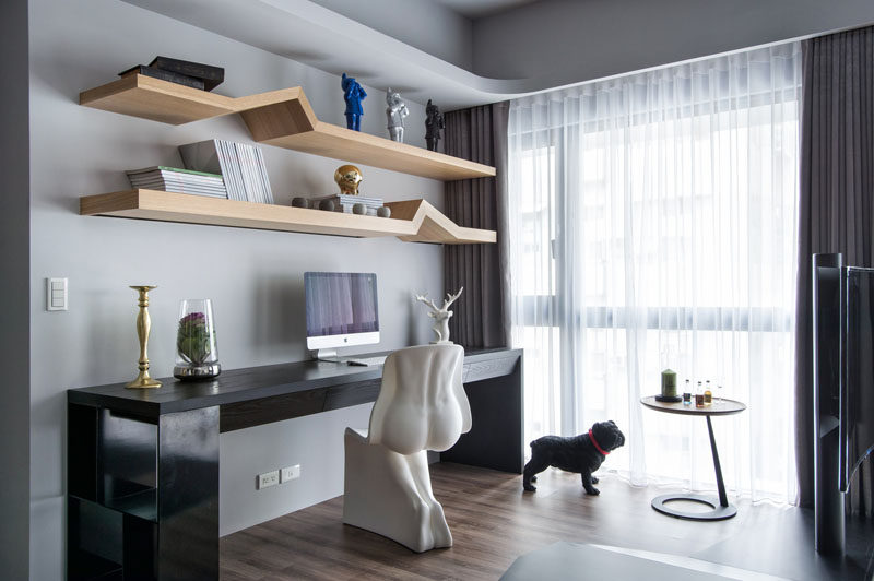 Apartment Design Idea - Divide Space By Slightly Elevating An Area. This home office is on a raised platform in the living room.