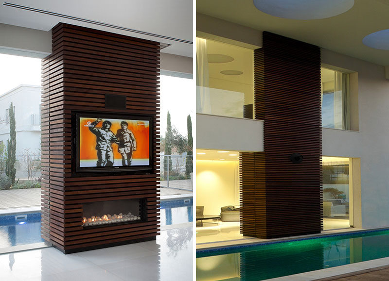 Wrapping an unsightly pillar or inconvenient wall in wood slats and installing a television and fireplace within its design, is a great way to turn otherwise dead space in your home into a functional and unique design detail.