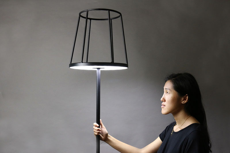 Designer Kevin Chiam has recreated the classic floor lamp, but with a modern twist. Instead of the light hidden by a lampshade, the shade is just a silhouette, with the light shining out from the base of the shade, making way to display your favorite item.