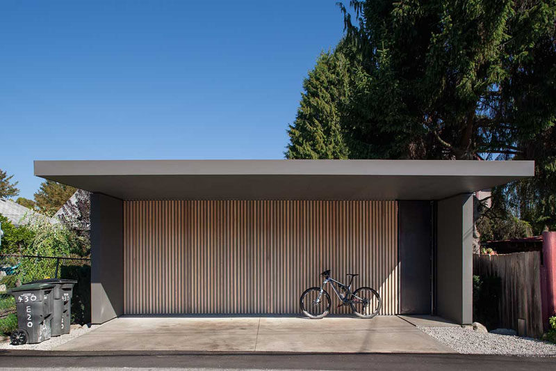 18 Inspirational Examples Of Modern Garage Doors // The thin light wood vertical panels on this garage door make for a modern statement and a unique door.