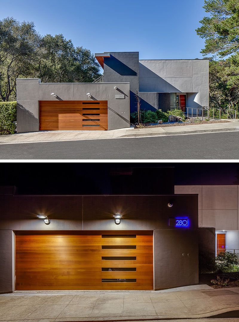 18 Inspirational Examples Of Modern Garage Doors // The five horizontal windows of this garage door give it a unique look while the lights above it give the front of the home added security.