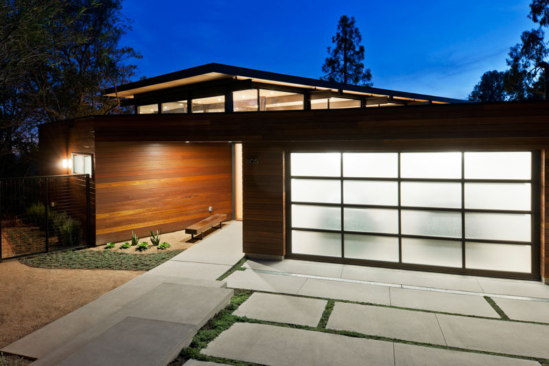 18 Inspirational Examples Of Modern Garage Doors // Frosted glass panels provide privacy and brighten the exterior when lit from the inside.