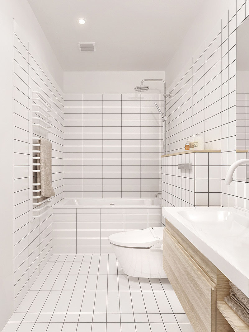 8 Examples Of Tile Flooring With Geometric Patterns // The floor of this bathroom is covered in clean white rectangular tiles mixed with a single line of square tiles to add a touch of interest.