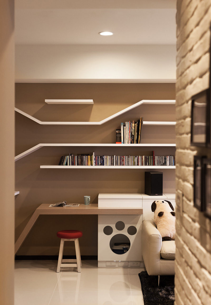 10 Ideas For Hiding Your Cats Litter Box // The paw print cutout in the bottom part of this built-in shelving system is the entrance to the hidden litter box.