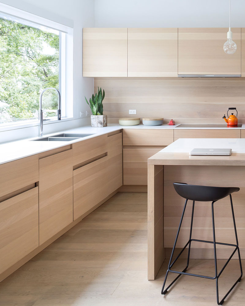 KITCHEN DESIGN IDEA --- These light wood cabinets have finger pulls instead of hardware, making it more contemporary and streamlined.