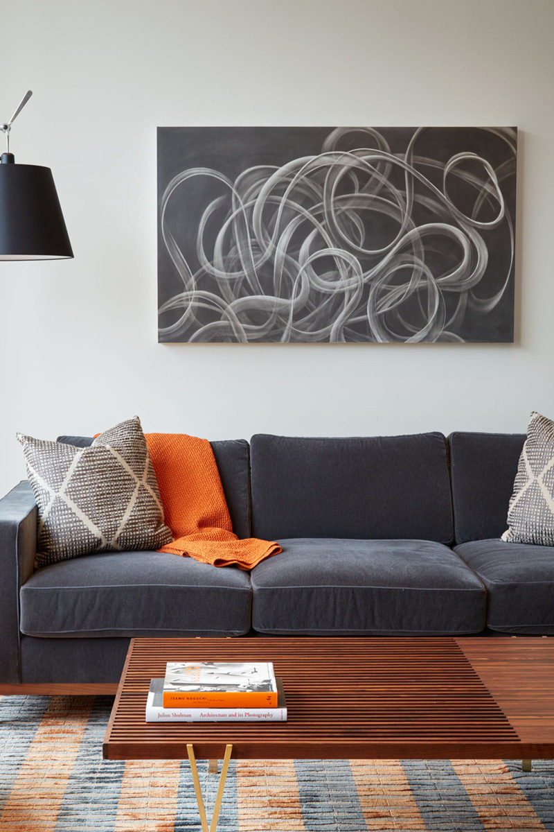 LIVING ROOM COLOR PALETTE --- Grey tones, wood and orange
