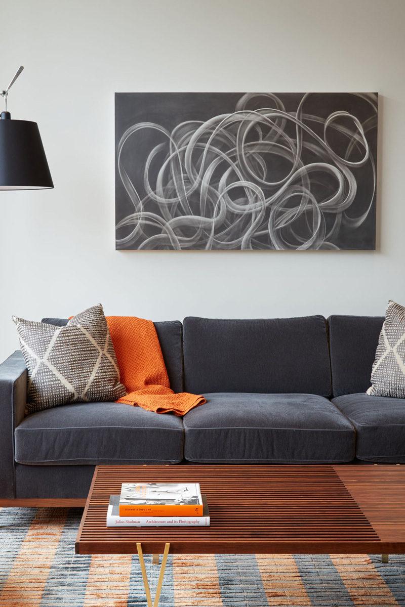 LIVING ROOM COLOR PALETTE --- Grey tones, wood and orange