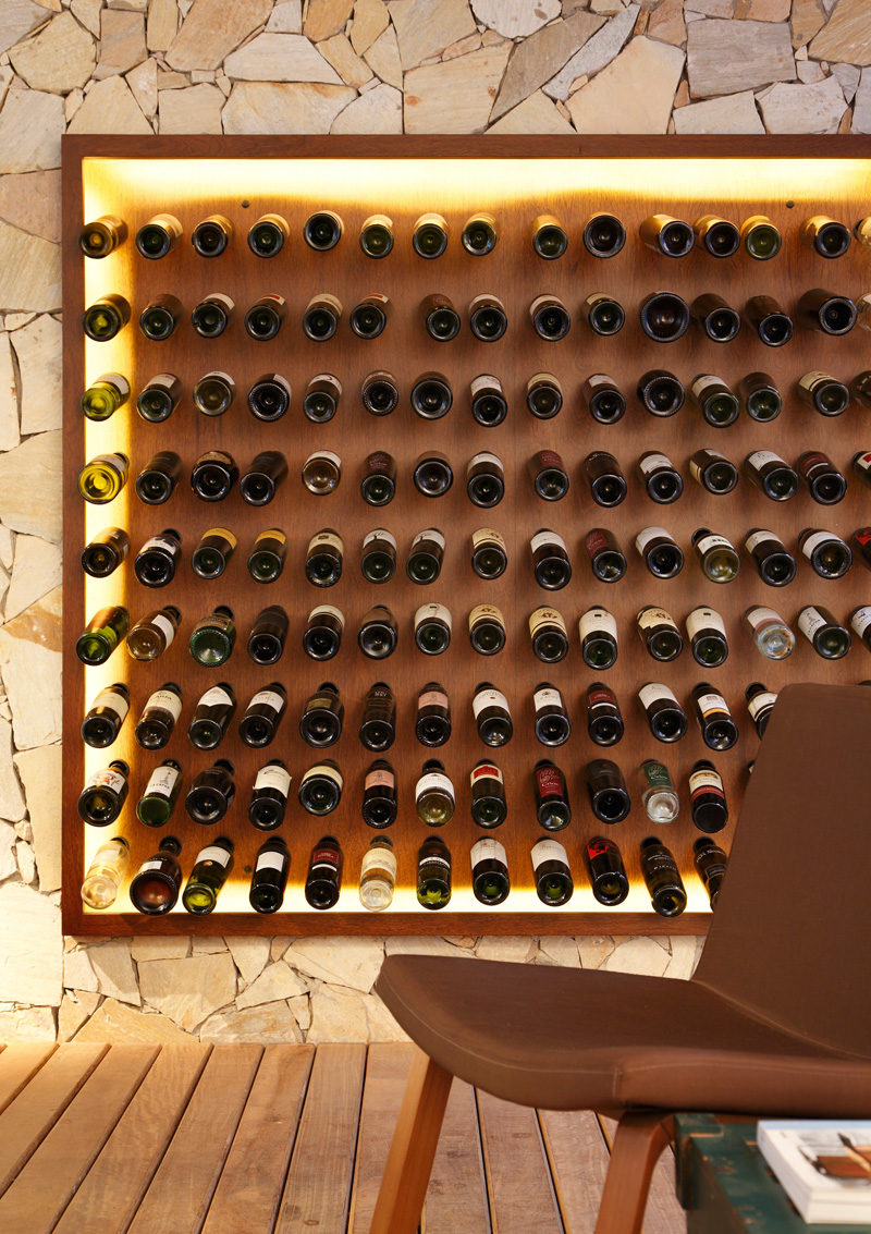 This backlit wall of wine storage featured in a bar in São Paulo, Brazil.