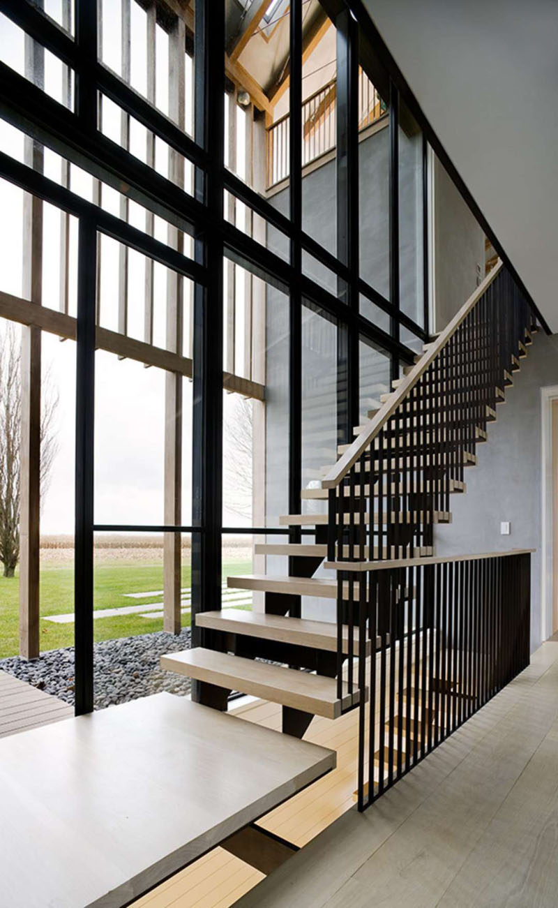 These stairs that allow you to enjoy the view through the wall of windows as you walk up and down them.
