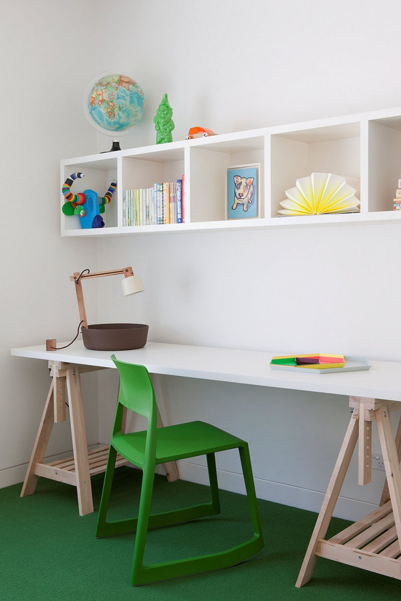 This children's homework station is a simple green and white colour palette with touches of light wood.