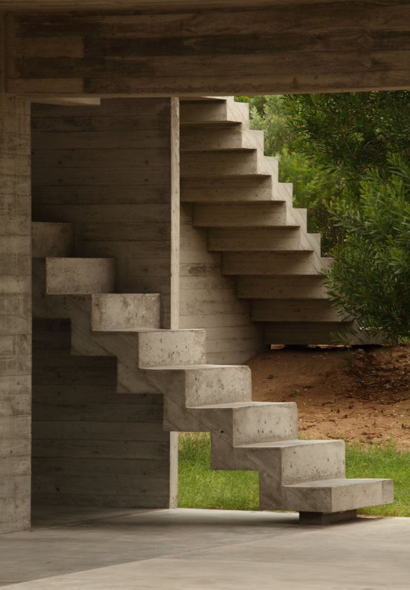 These concrete stairs guide you from the outdoor areas of the home to the inside spaces.