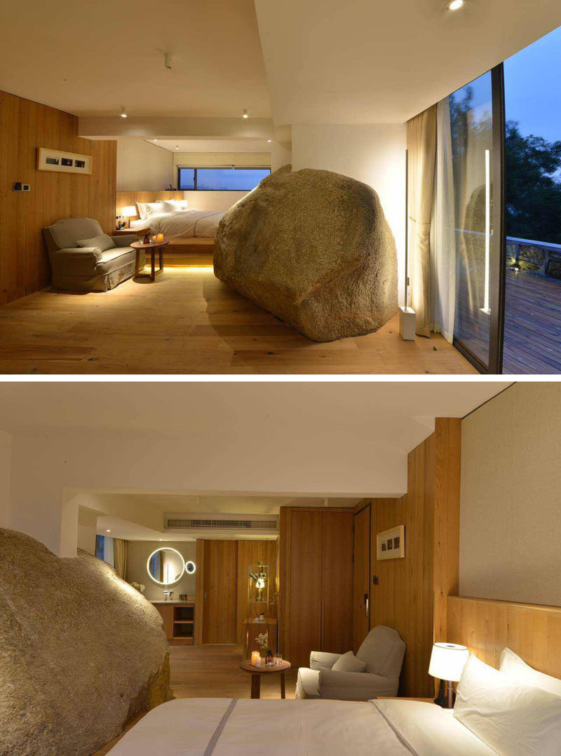 Designed by C+ Architects and Naza design studio, the Nashare Hotel is located in a tranquil forest in Xiamen, China, and in some of the hotel rooms they have worked around large boulders and rock walls, to create a natural element that is unexpected.