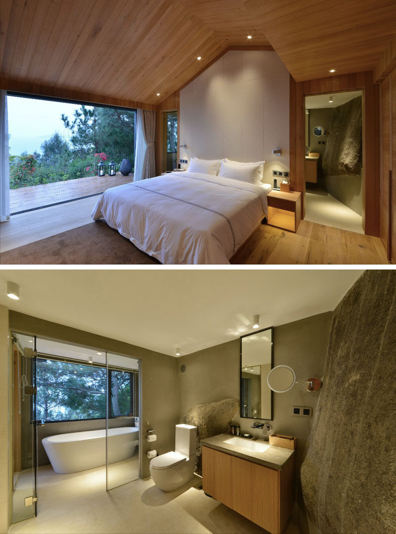 This hotel room in China has a large natural rock feature in the bathroom, and a deck next to the bed provides amazing views of the forest in Xiamen