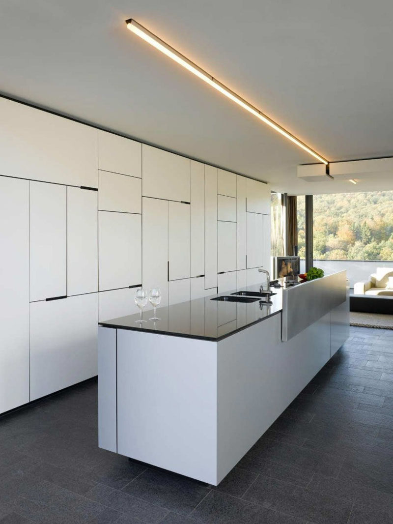 KITCHEN CABINETRY IDEA - Your kitchen cabinets don't have to be boring, consider a jumble of cabinet sizes instead of an organized look.
