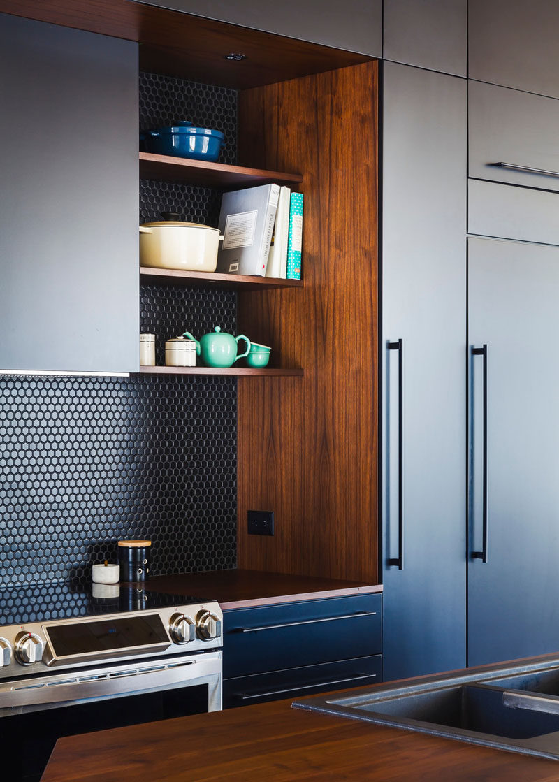 9 Inspirational Pictures Of Kitchens With Geometric Tiles // Dark hexagon tiles in this kitchen contrast the wood shelving and countertops to create a dramatic effect.