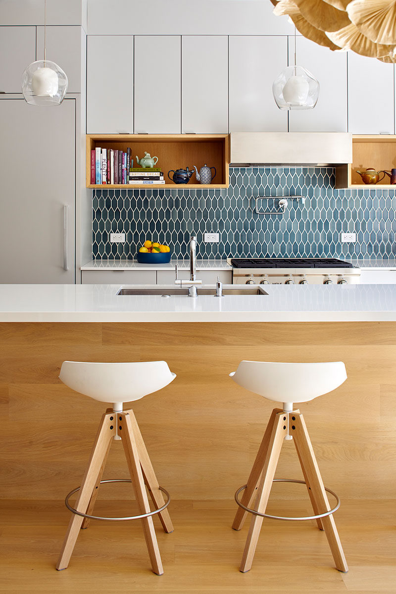 9 Inspirational Pictures Of Kitchens With Geometric Tiles // The blue hexagon tiles have been elongated to give the backsplash of this bright kitchen a unique touch.
