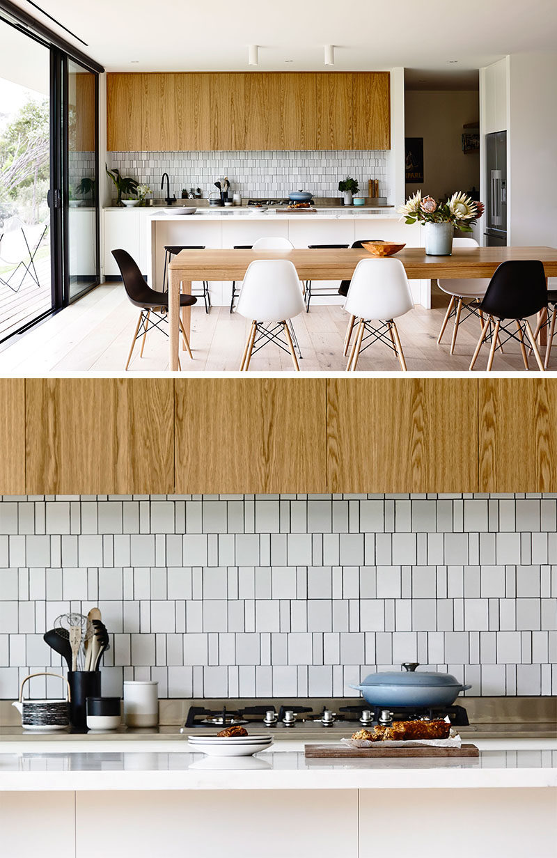 9 Inspirational Pictures Of Kitchens With Geometric Tiles // The backsplash of this kitchen uses white rectangular tiles in various sizes to create a textured appearance.
