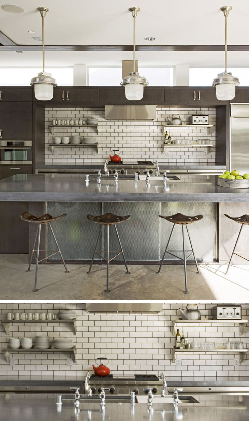 9 Inspirational Pictures Of Kitchens With Geometric Tiles // The dark grout used to fill the spaces between the white subway tiles match the other dark elements in the kitchen, like the cabinetry and bar stools.