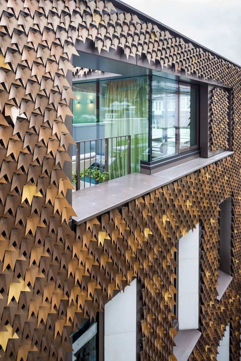 4080 folded aluminum leaves cover the facade of this home in London.