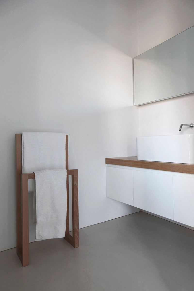 6 Ideas For Creating A Minimalist Bathroom // Stick To Simple Materials --- Adding touches of wood or concrete to offset an all white bathroom adds texture and warmth to the bathroom while keeping a simple aesthetic.