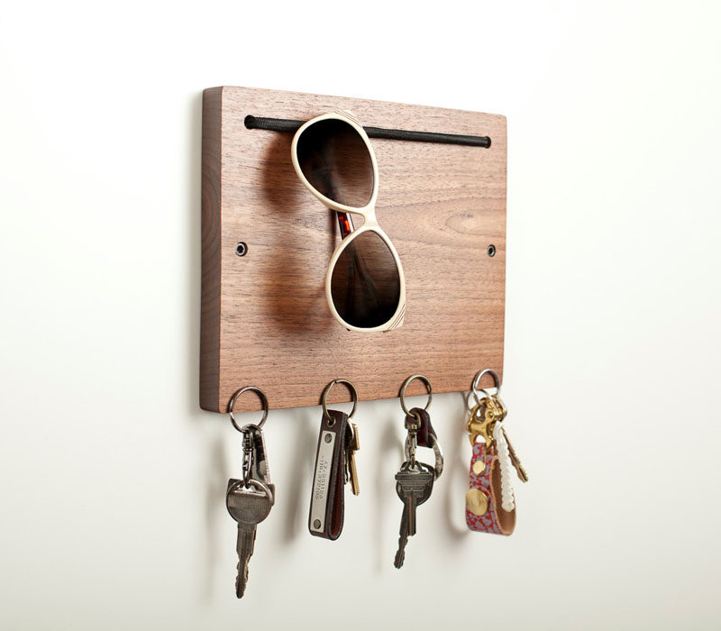 16 Key Holders To Keep You Organized // This modern wooden key holder has a spot to hang your sunglasses and your keys.