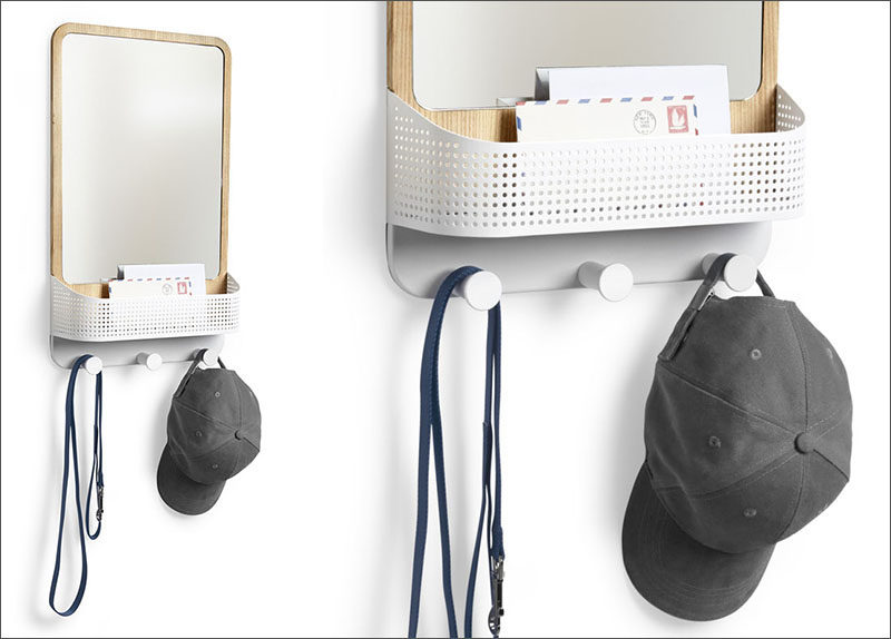 16 Key Holders To Keep You Organized // This wall hook has a mirror, a basket, and a set of hooks ideal for hanging keys, hats and other lightweight things.