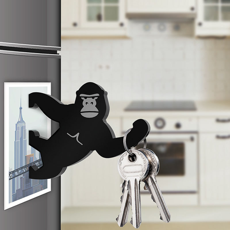 16 Key Holders To Keep You Organized // Stick this gorilla to your fridge and you'll always have a place to keep your keys and a handy helper to crack open bottles.
