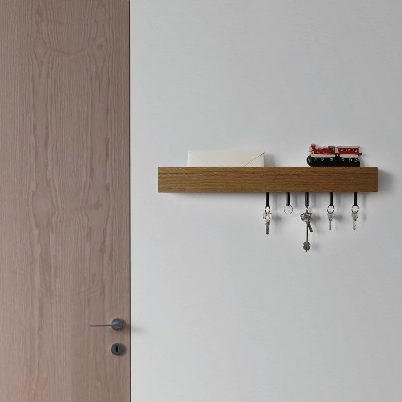 16 Key Holders To Keep You Organized // This key holder comes with magnetic key chains to add to your keys and creates a convenient organizer for your entry way.