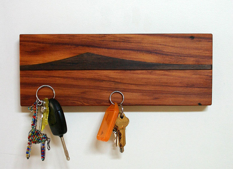 16 Key Holders To Keep You Organized // Add a small piece of artwork to your wall with this magnetic wooden key holder featuring an island view from New Zealand.
