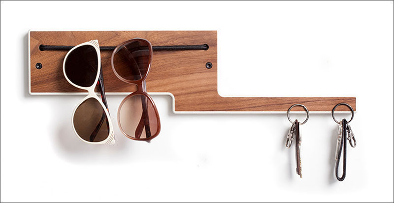 16 Key Holders To Keep You Organized // This entry way organizer uses embedded magnets to hold your keys while an elastic band keeps sunglasses at the ready.