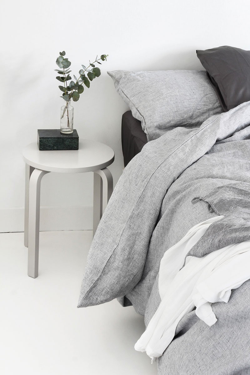 9 Different Ideas For Adding A Nightstand To Your Bedroom // 9 Different Ideas For Adding A Nightstand To Your Bedroom // A Simple Stool --- Keep bedside clutter to a minimum by using a small table that's just large enough for a book, a light, and some greenery.