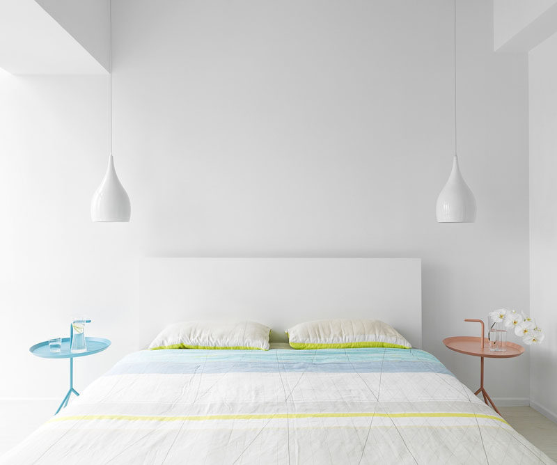 9 Different Ideas For Adding A Nightstand To Your Bedroom // His And Hers --- The pink and blue bedside tables could indicate which side each person sleeps on.