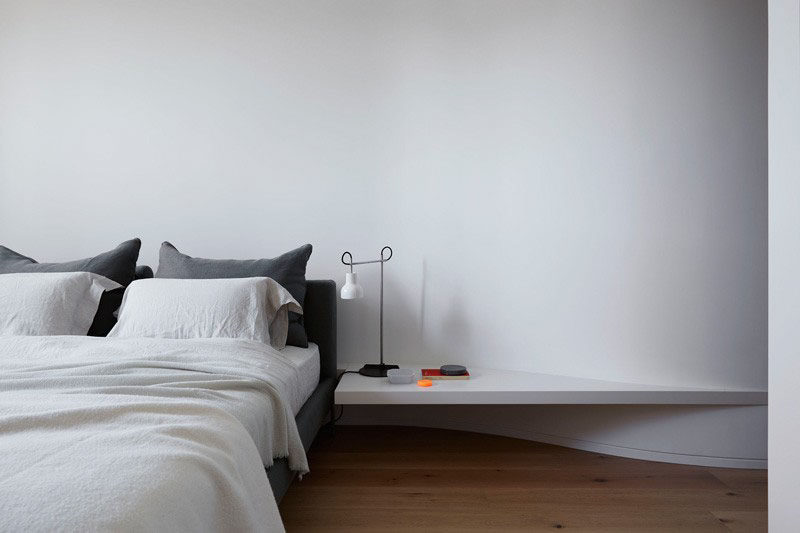 9 Different Ideas For Adding A Nightstand To Your Bedroom // Build It Right Into The Wall --- This nightstand seems to emerge right out of the wall and creates a seamless look against it.