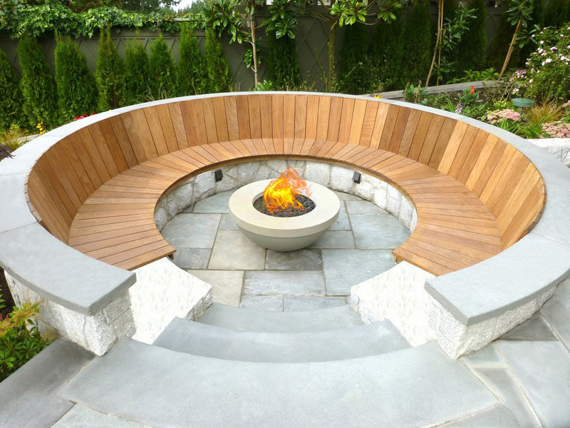 15 Outdoor Conversation Pits Built For Entertaining // Stone and wood circle this fire pit and create a warm atmosphere, perfect for catching up with old friends. #ConversationPit #FirePit #YardIdeas