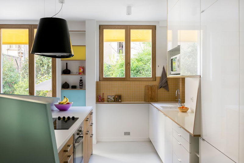 This small kitchen is partially closed off from the dining and living room by an angled pony wall.